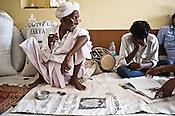75-year-old Manganiyar artist turns to see the book on Manganiyar musicians inside his house in Hamira village of Jaiselmer district in Rajasthan, India. Photo: Sanjit Das/Panos