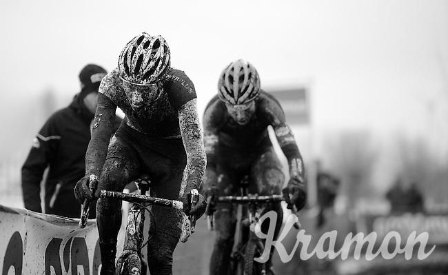 Mathieu Vanderpoel (NLD/BKCP-Powerplus) & Wout Van Aert (BEL/Vastgoedservice-Golden Palace) fighting it out between them in a sea of sticky black mud<br /> <br /> Azencross Loenhout 2014