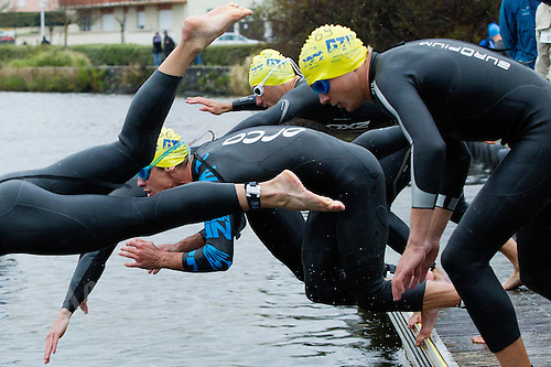 28 APR 2012 - LES SABLES D'OLONNE, FRA - The GT Vesoul Haute-Saone team dive into the water at the start of the prologue round of the men's French Grand Prix Series triathlon in Les Sables d'Olonne, France (PHOTO (C) 2012 NIGEL FARROW)