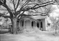 Infrared house and live oak, Llano, Texas.<br /> <br /> Nikon F3HP, 24mm lens, Kodak High Speed Infrared film, red filter
