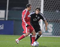 Chicago Fire midfielder Cuauhtemoc Blanco (10) controls the ball against DC United defender Dejan Jcovic (5). Chicago Fire tied DC United 1-1 at RFK Stadium, Saturday, March 28, 2009.