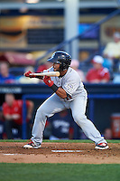 New Britain Rock Cats catcher Jan Vazquez (11) squares to bunt during a game against the Reading Fightin Phils on August 7, 2015 at FirstEnergy Stadium in Reading, Pennsylvania.  Reading defeated New Britain 4-3 in ten innings.  (Mike Janes/Four Seam Images)