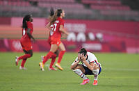 KASHIMA, JAPAN - AUGUST 2: Carli Lloyd #10 of the United States reacts to the USA loss after a game between Canada and USWNT at Kashima Soccer Stadium on August 2, 2021 in Kashima, Japan.