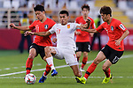 Zhang Chengdong of China (C) competes for the ball with Hwang Heechan (L) and Lee Chungyong of South Korea (R) during the AFC Asian Cup UAE 2019 Group C match between South Korea (KOR) and China (CHN)  at Al Nahyan Stadium on 16 January 2019 in Abu Dhabi, United Arab Emirates. Photo by Marcio Rodrigo Machado / Power Sport Images