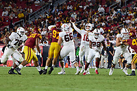 LOS ANGELES, CA - SEPTEMBER 11: Tanner McKee #18 of the Stanford Cardinal throws a pass during a game between University of Southern California and Stanford Football at Los Angeles Memorial Coliseum on September 11, 2021 in Los Angeles, California.