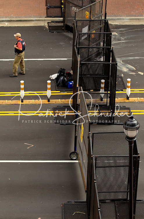 Security guards patrol inside fencing erected outside the headquarters of Bank of America before the start of the Democratic National Conventionin Charlotte, North Carolina.