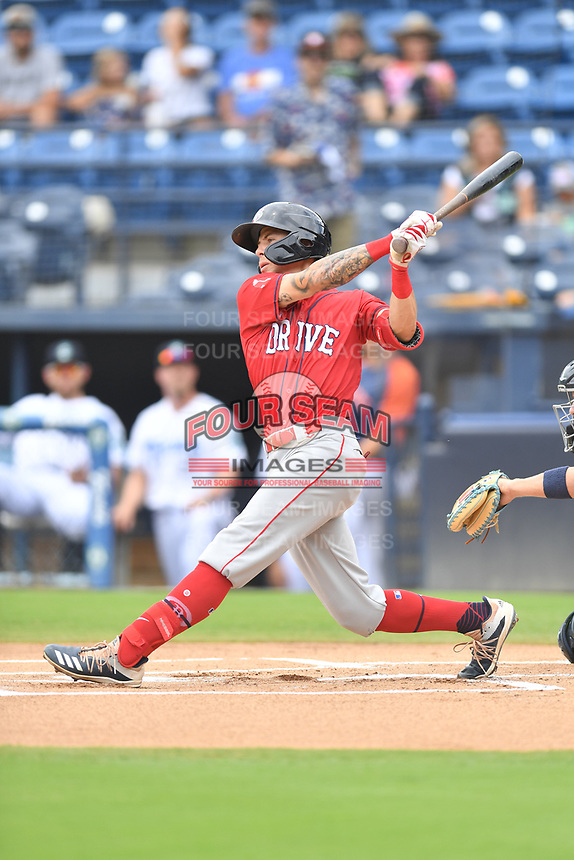 Greenville Drive Christian Koss (8) swings at a pitch during a game against the Asheville Tourists on July 18, 2021 at McCormick Field in Asheville, NC. (Tony Farlow/Four Seam Images)