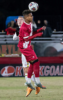 COLLEGE PARK, MD - NOVEMBER 15: Herbert Endeley #17 of Indiana heads past Ben Di Rosa #25 of Maryland during a game between Indiana University and University of Maryland at Ludwig Field on November 15, 2019 in College Park, Maryland.