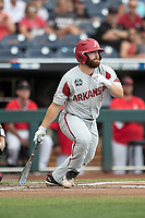 Arkansas Razorbacks first baseman Trevor Ezell (4) follows through on his swing during Game 5 of the NCAA College World Series against the Texas Tech Red Raiders on June 17, 2019 at TD Ameritrade Park in Omaha, Nebraska. Texas Tech defeated Arkansas 5-4. (Andrew Woolley/Four Seam Images)
