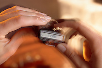 Blurred motion image of a vibrating pager.