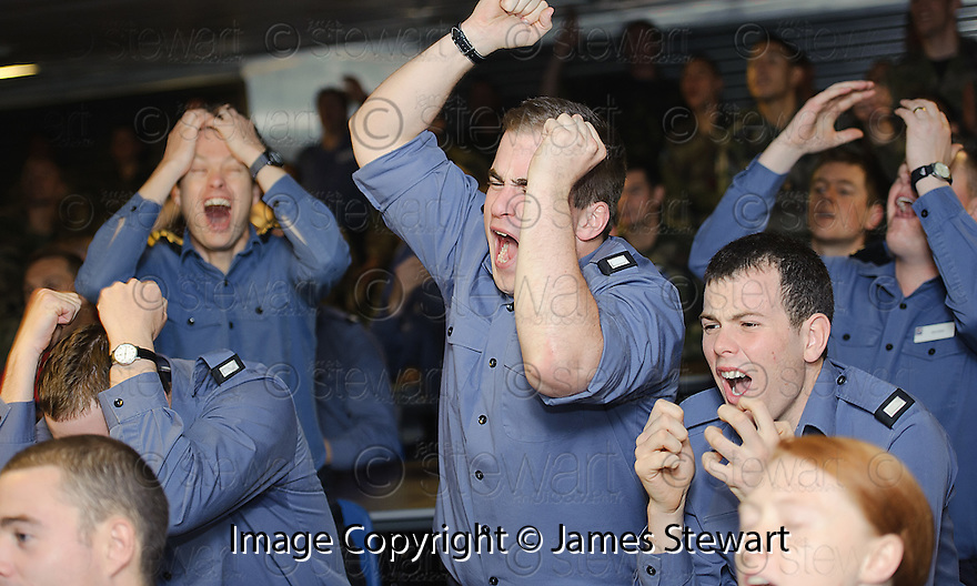 A MOMENT OF EXCITEMENT TURNS TO DESPAIR FOR THESE ENGLAND FANS AS THEY WATCH THE RUGBY WORLD CUP QUARTER FINAL BETWEEN FRANCE AND ENGLAND ON THE HMS BULWARK WHILST ON A BREAK FROM A JOINT EXERCISE IN LOCH EWE AND OFF THE SCOTTISH ATLANTIC COAST