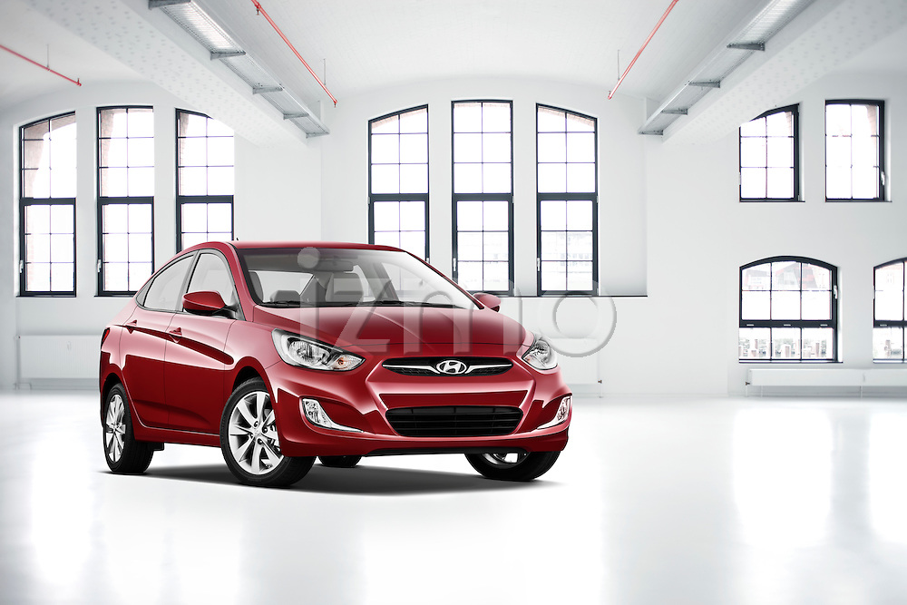 One red 2012 Hyundai Accent GLS Sedan inside a large urban industrial loft.