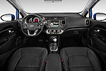 Stock photo of straight dashboard view of 2015 KIA Rio AT SX 5 Door Hatchback 2WD Dashboard