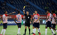 BARRANQUILLA - COLOMBIA, 22-09-2021: Luis Matorel, arbitro muestra tarjeta amarilla a Wilder Ditta de Atletico Junior, durante partido pospuesto entre Atletico Junior y Atletico Huila de la fecha 8 por la Liga BetPlay DIMAYOR II 2021 jugado en el estadio Metropolitano Roberto Melendez de la ciudad de Barranquilla. / Luis Matorel, referee shows yellow card to Wilder Ditta of Atletico Junior during a posponed match between Atletico Junior and Atletico Huila of the 8th date for the BetPlay DIMAYOR II 2021 League played at the Metropolitano Roberto Melendez Stadium in Barranquilla city. / Photo: VizzorImage / Jairo Cassiani / Cont.