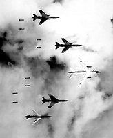 Vietnam -  June 14, 1966. - <br /> <br /> Flying under radar control with a B-66 Destroyer, Air Force F-105 Thunderchief pilots bomb a military target through low clouds over the southern panhandle of North Viet Nam.  June 14, 1966.  Lt. Col. Cecil J. Poss, USAF.  (USIA)