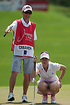 CHON BURI, THAILAND - FEBRUARY 20:  Paula Creamer of USA and caddie line up a putt on the 4th hole during day four of the LPGA Thailand at Siam Country Club on February 20, 2011 in Chon Buri, Thailand. Photo by Victor Fraile / The Power of Sport Images
