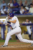 LSU Tigers second baseman JaCoby Jones #23 follows through on his swing against the Auburn Tigers in the NCAA baseball game on March 22nd, 2013 at Alex Box Stadium in Baton Rouge, Louisiana. LSU defeated Auburn 9-4. (Andrew Woolley/Four Seam Images).