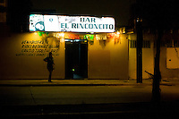 """Mexico is a very divided society depending in the economic status, ideology, religion and education and like this bar at the red zone of Ensenada (red zone is an area that you can find all that people that the society consider like """"low class"""", junkies,street alcoholics, cheap prostitution ore people that just """"survive"""" and the places that them hang out, like bars, table-dance bars, discos, etc. Locals call it """"El Bajio"""") you can find cheap beers,1.60 usd the caguama (940ml beer), and  a variety of people that you don't usually see at the streets of Ensenada."""