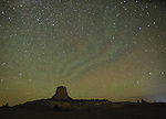 """Perseids meteor shower over Devil's Tower National Monument, WY, with """"green air"""""""