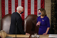 Speaker of the United States House of Representatives Nancy Pelosi (Democrat of California) and US Vice President Mike Pence preside over a joint session of Congress to certify the 2020 electoral college results on Capitol Hill in Washington, DC.<br /> Credit: Erin Schaff / Pool via CNP/AdMedia