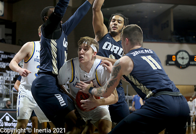 SIOUX FALLS, SD - MARCH 8: Baylor Scheierman #3 of the South Dakota State Jackrabbits is surrounded by a trip of players including DeShang Weaver #14 and Carlos Jurgens #11 of the Oral Roberts Golden Eagles during the Summit League Basketball Tournament at the Sanford Pentagon in Sioux Falls, SD. (Photo by Dave Eggen/Inertia)