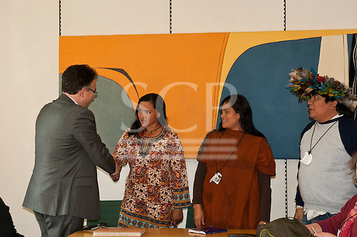 London, England. Martin Horwood MP, chair of the parliamentary group for tribal peoples, greets Sheyla Yakarepi Juruna, Ruth Buendia Mestoquiari Ashaninka and Chief Almir Narayamoga Surui during their visit to London to highlight the impact of hydroelectric dams proposed for the rivers of the Amazon basin, 02/03/2011.