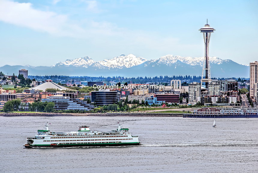 A view across the Puget Sound toward Seattle, the Space Needle, and Cascade mountatins, Washington State.