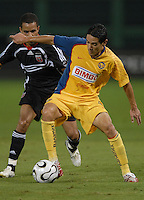 Club America defender Oscar Rojas (4) shields the ball against DC United midfielder Fred (7). DC United defeated Club America 1-0 to secure one of the two semifinal berths in SuperLiga group B, at RFK Stadium in Washington DC, Sunday July 29, 2007.