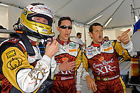 (L to R): Mark Wilkins, Burt Frisselle and Ozz Negri react to the spinning #99 Gainsco/Bob Stallings Racing Chevrolet/Riley on the TV feed in their pit., #60 Michael Shank Racing Ford/Riley