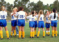 A girls soccer team prepares for a game, teamwork, sportsmanship, sports, teams. California.