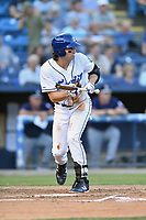 Asheville Tourists shortstop Ryan Vilade (4) squares to bunt during a game against the Rome Braves at McCormick Field on August 31, 2018 in Asheville, North Carolina. The Braves defeated the Tourists 11-7. (Tony Farlow/Four Seam Images)
