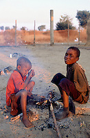 Angola. Cuando Cubango. Mavinga. Early morning, young boys are getting warm by the fire. The children are treated for malnutrition in the suplementary feeding center run by MSF (Médecins Sans Frontières) Switzerland.  © Didier Ruef