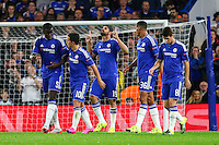 Diego Costa of Chelsea (centre) celebrates scoring his team's third goal against Maccabi Tel-Aviv to make it 3-0 during the UEFA Champions League match between Chelsea and Maccabi Tel Aviv at Stamford Bridge, London, England on 16 September 2015. Photo by David Horn.
