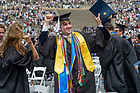 May 23, 2021;  A graduate celebrates after the Commencement Ceremony in the Notre Dame Stadium.  (Photo by Barbara Johnston/University of Notre Dame)