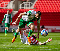5th April 2021; Bet365 Stadium, Stoke, Staffordshire, England; English Football League Championship Football, Stoke City versus Millwall; Steven Fletcher of Stoke City is slide tackled by Murray Wallace of Millwall