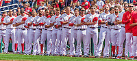 20 September 2015: The Washington Nationals stand in front of the dugout during the National Anthem prior to a game against the Miami Marlins at Nationals Park in Washington, DC. The Nationals defeated the Marlins 13-3 to take the final game of their 4-game series. Mandatory Credit: Ed Wolfstein Photo *** RAW (NEF) Image File Available ***