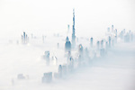 ONLINE ARE RESTRICTED TO A MAXIMUM OF 10 IMAGES  FROM THIS SET TO RUN ALONGSIDE THE STORY<br /> <br /> Pictured: Taken from a plane:  Dubai in fog.<br /> <br /> Amazing drone shots show a Mongolian tribesman sledding across a frozen lake, the skyscrapers of Dubai shrouded in mist and a fluorescent blue stream winding its way through the ice of Greenland.  Other images show fields of flowers in Italy and a herd of livestock being guided through the desert.<br /> <br /> The patterned pictures - which resemble modern art - were captured by photographer Alessandra Meniconzi from Lugano, Switzerland.  SEE OUR COPY FOR DETAILS.<br /> <br /> Please byline: Alessandra Meniconzi/Solent News<br /> <br /> © Alessandra Meniconzi/Solent News & Photo Agency<br /> UK +44 (0) 2380 458800