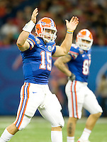 01 January 2010:  Tim Tebow of Florida celebrates after he threw 80 yards touchdown pass during the game against Cincinnati during Sugar Bowl at the SuperDome in New Orleans, Louisiana.  Florida defeated Cincinnati, 51-24.