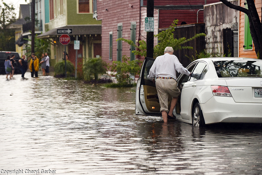 Heavy rains flooded streets in the historic Faubourg Marigny after city pumps were overwhelmed, New Orleans, Sat., Aug. 5, 2017. (Photo by Cheryl Gerber)