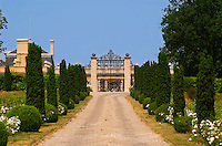 The imposing entrance to Chateau Haut Sarpe, the road lined with bushes leading up to the gate Saint Emilion Bordeaux Gironde Aquitaine France