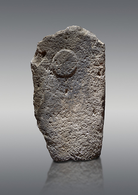 Late European Neolithic prehistoric Menhir standing stone with carvings on its face side.  Menhir Museum, Museo della Statuaria Prehistorica in Sardegna, Museum of Prehoistoric Sardinian Statues, Palazzo Aymerich, Laconi, Sardinia, Italy. Grey background.