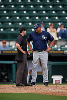 Charlotte Stone Crabs manager Jeff Smith (41) talks with umpire Tanner Dobson during a Florida State League game against the Bradenton Marauders on April 10, 2019 at LECOM Park in Bradenton, Florida.  Bradenton defeated Charlotte 2-1.  (Mike Janes/Four Seam Images)