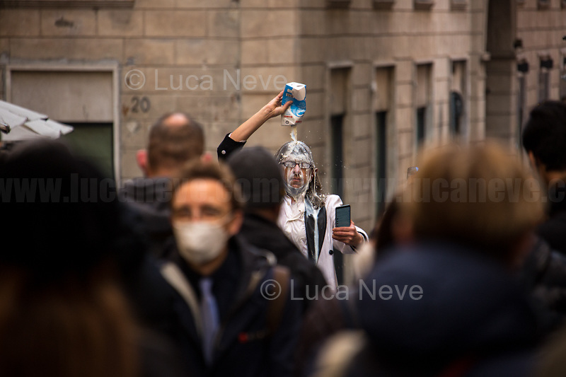 Man pours milk on his head. <br /> <br /> Rome, 06/02/2021. Today, the designated Italian Prime Minister - and former President of the European Central Bank -, Mario Draghi, held his third day of consultations at Palazzo Montecitorio, meeting delegations of the Italian political parties in his attempt to form the new Italian Government.
