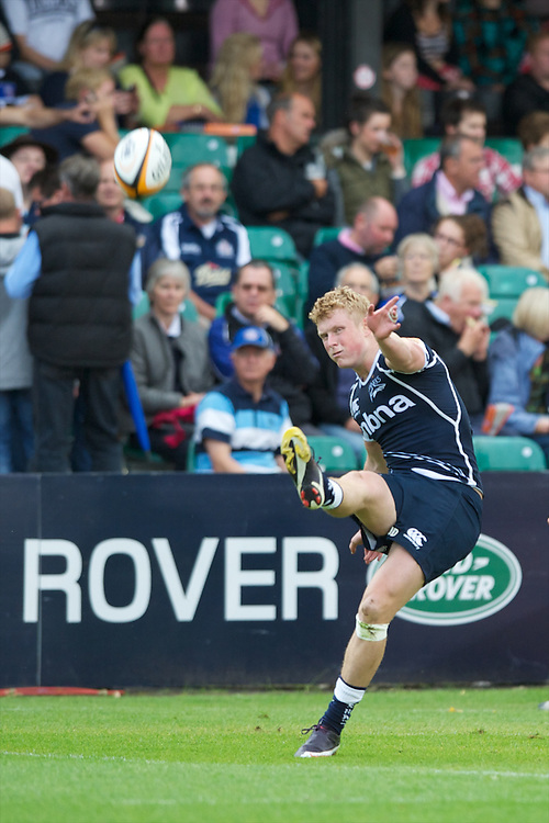 20120803 Copyright onEdition 2012©.Free for editorial use image, please credit: onEdition..Jordan Davies of Sale Sharks kicks a conversion against Saracens 7s at The Recreation Ground, Bath in the Final round of The J.P. Morgan Asset Management Premiership Rugby 7s Series...The J.P. Morgan Asset Management Premiership Rugby 7s Series kicked off again for the third season on Friday 13th July at The Stoop, Twickenham with Pool B being played at Edgeley Park, Stockport on Friday, 20th July, Pool C at Kingsholm Gloucester on Thursday, 26th July and the Final being played at The Recreation Ground, Bath on Friday 3rd August. The innovative tournament, which involves all 12 Premiership Rugby clubs, offers a fantastic platform for some of the country's finest young athletes to be exposed to the excitement, pressures and skills required to compete at an elite level...The 12 Premiership Rugby clubs are divided into three groups for the tournament, with the winner and runner up of each regional event going through to the Final. There are six games each evening, with each match consisting of two 7 minute halves with a 2 minute break at half time...For additional images please go to: http://www.w-w-i.com/jp_morgan_premiership_sevens/..For press contacts contact: Beth Begg at brandRapport on D: +44 (0)20 7932 5813 M: +44 (0)7900 88231 E: BBegg@brand-rapport.com..If you require a higher resolution image or you have any other onEdition photographic enquiries, please contact onEdition on 0845 900 2 900 or email info@onEdition.com.This image is copyright the onEdition 2012©..This image has been supplied by onEdition and must be credited onEdition. The author is asserting his full Moral rights in relation to the publication of this image. Rights for onward transmission of any image or file is not granted or implied. Changing or deleting Copyright information is illegal as specified in the Copyright, Design and Patents Act 1988. If you are in any way unsure of your right to publish thi