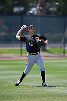 Pittsburgh Pirates left fielder Ryan Nagle (49) throws back to the infield during a minor league Spring Training game against the Philadelphia Phillies on March 24, 2017 at Carpenter Complex in Clearwater, Florida.  (Mike Janes/Four Seam Images)