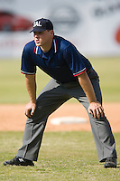 Spencer Flynn handles the umpire duties in the field during the South Atlantic League contest between the Charleston RiverDogs and the Hickory Crawdads at L.P. Frans Stadium in Hickory, NC, Sunday, May 4, 2008.