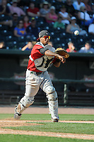 Fort Wayne TinCaps catcher Rodney Daal (6) throws to first during a game against the Great Lakes Loons on August 18, 2013 at Dow Diamond in Midland, Michigan.  Fort Wayne defeated Great Lakes 4-3.  (Mike Janes/Four Seam Images)