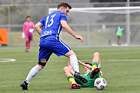 Isaac Snell of Petone FC competes for the ball with Luis Toomey of Lower Hutt AFC  during the Central League Football - Petone FC v Lower Hutt AFC at Petone Memorial Park, Lower Hutt, New Zealand on Friday 2 April 2021.<br /> Copyright photo: Masanori Udagawa /  www.photosport.nz