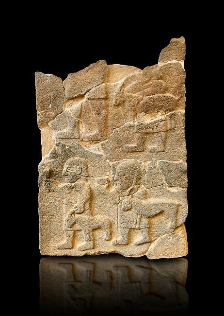 Pictures & images of the South Gate Hittite sculpture stele depicting Hittite Gods. 8th century BC. Karatepe Aslantas Open-Air Museum (Karatepe-Aslantaş Açık Hava Müzesi), Osmaniye Province, Turkey. Against black background