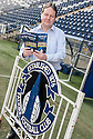 Falkirk Director and General Manger, David White, with the Falkirk FC Player Fact File, containing details of all the young players and given to scouts who attend matches at The Falkirk Stadium.
